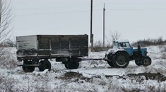 Tractor trailer slips stuck in the snow on the road winter Stock Footage