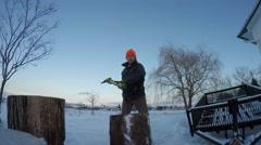 4k man splits wood fisheye view Stock Footage