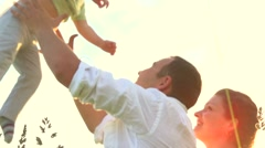 Happy family with little baby outdoors Stock Footage
