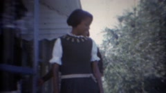 1967: African American mother and daughter formally dressed with wacky yellow Stock Footage