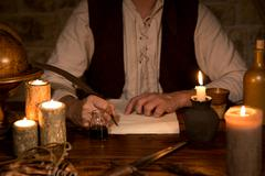 Signing a document, medieval theme Stock Photos