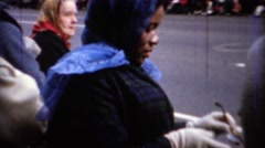 1967: African American mom front row on parade route. CHICAGO, ILLINOIS - stock footage