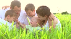 Happy smiling big family with children having fun outdoors Stock Footage