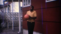 1967: Kids shooting basketball backyard garage hoop. CARMEL, INDIANA - stock footage