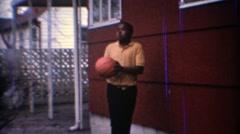 1967: Kids shooting basketball backyard garage hoop. CARMEL, INDIANA Stock Footage