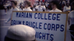 1967: Marian College drum bugle corps marching band parade.  CHICAGO, ILLINOIS Stock Footage