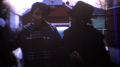 1967: Mouthy African American teenager bosses mother around. CARMEL, INDIANA Stock Footage