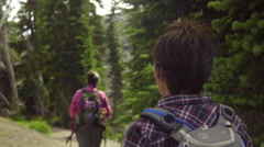 Over the shoulder shot of two women hiking Stock Footage