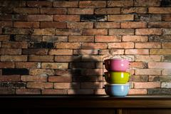 Colorful tiffin carrier on wooden cupboard Stock Photos