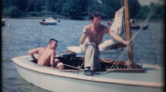 3166 sailboat ride with friends at local lake - vintage film home movie Stock Footage