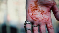 Suicidal man cutting veins, blood running down person's hand, clenching fist Stock Footage