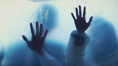 Souls of dead people smearing blood on transparent surface, scary horror film Stock Footage