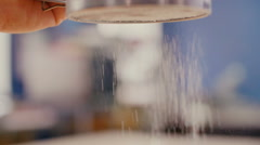 Flour sifting through a sieve for a baking Stock Footage