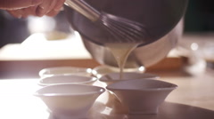 pour the batter into the mold - stock footage
