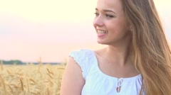 Beauty girl with healthy long hair enjoying nature on wheat field - stock footage