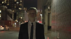 Excited young businessman dancing in the city street at night. shot on red epic Stock Footage
