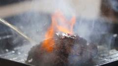 Steak ignited fire close-up Stock Footage