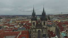 Flying over the towers of Tyn Church in Prague Stock Footage