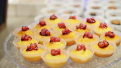 Set of cute cakes under glass dome - stock footage