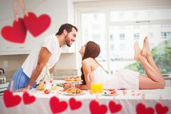 Composite image of young couple having a romantic breakfast - stock photo