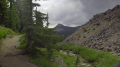 Stock Video Footage of Hiker walks in beautiful scenery