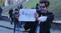 Funny guy with scary zombie makeup on face offering free hugs to passers-by Footage