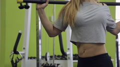 Stock Video Footage of A blonde woman athlete, with muscular body doing exercise on the abdominal
