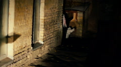 Stock Video Footage of Strange female in ragged bloody clothes limping in dangerous dark street