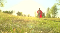 Little Boy wearing Super hero costume Runs In Summer Park. Stock Footage