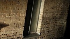 Scary place, grated window in old brick wall, abandoned building, criminal lair Stock Footage