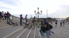 Selling bags on a bridge on Riva degli Schiavoni, Venice Stock Footage