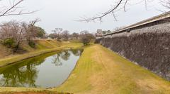 Perspective View of Moat and Wall of Castle - stock photo