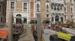 Boats moored in front of La Biennale di Venezia building Venice Stock Footage