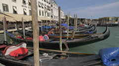 Gondolas moored along Graand Canal's buildings in Venice Stock Footage