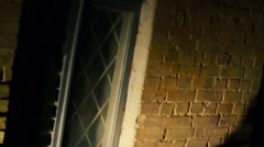 Shadow of cruel maniac chopping victim in dark backstreet, terrible murder Stock Footage