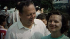 1969: Middle aged man putting arm around younger wife. NIAGRA FALLS, NEW YORK Stock Footage