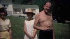 1968: Family enjoying summer sunshine drinking cans of soda pop. TAMPA, FLORIDA Stock Footage