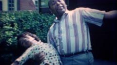 1967: Father and daughter clowning around with dancing dip. CARMEL, INDIANA - stock footage