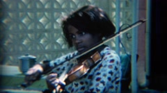 1967: African American teenager practicing classical violin music. CARMEL, Stock Footage