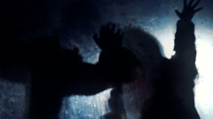 Silhouettes of scary beasts stretching hands towards victim, scary nightmare Stock Footage