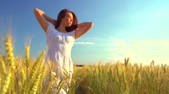 Beauty girl running on yellow wheat field. Freedom concept. Stock Footage