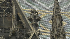 Small tower and glazed tiles on St. Stephen's Cathedral, Vienna Stock Footage