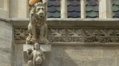 A gargoyle in the shape of a lion on Stephansdom, Vienna Stock Footage