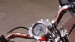 Vintage style cafe-racer motorcycle in garage. The reflection in the mirror Stock Footage
