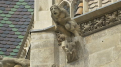 A gargoyle in the shape of a man on Stephansdom, Vienna - stock footage