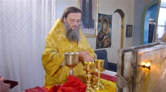 Priest preparing holy in the church Stock Footage