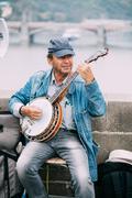 Street Busker performing jazz songs at the Charles Bridge in Pra Kuvituskuvat