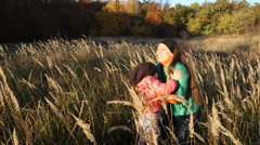 Mother with baby in nature - stock footage
