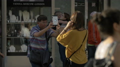 Asian couple taking pictures in Stephansplatz, Vienna Stock Footage