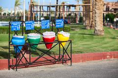 Color wastebaskets for separation of garbage are on the streets Stock Photos